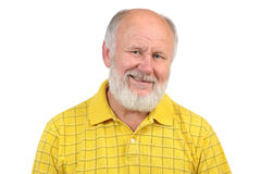 Senior bald man's gestures. Senior funny bald man in yellow t-shirt is shows gestures and grimaces Stock Photo
