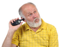 Senior bald man's picking his ear Royalty Free Stock Photography