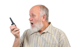 Senior bald man screaming to walkie-talkie Stock Photo