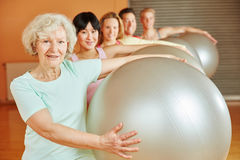 Senior during ball exercise in pilates Royalty Free Stock Photos