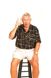 Senior on a bar chair. Royalty Free Stock Photo