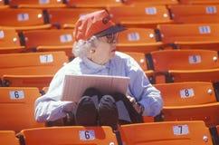 Senior Baseball fan taking statistics Stock Photos