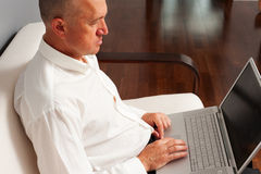 Senior basinessman working at home Royalty Free Stock Photo