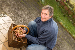 Senior with a basket walnuts Stock Photo