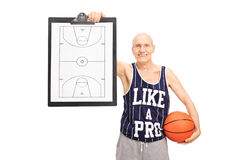 Senior basketball coach showing a clipboard. With a basketball court on it isolated on white background Royalty Free Stock Photography