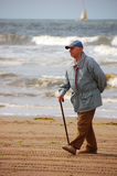Senior active on the beach. Senior walking on the beach royalty free stock photo