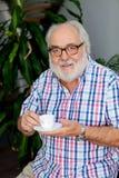 Senior bearded man drinking coffee Stock Photography