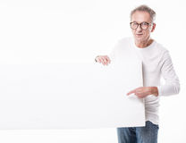 Senior beautiful man with empty white board. Senior handsome man Holding Together A Blank empty White Board Royalty Free Stock Photos