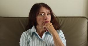 Senior beautiful woman doubting stock footage