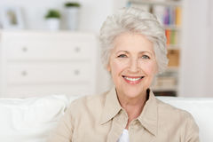 Senior beautiful woman enjoying the retirement royalty free stock image