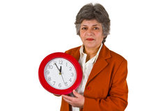 Senior beautiful woman holding a round clock Stock Images