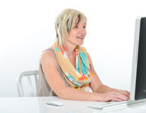 Senior beautiful young woman working at office with computer Stock Images