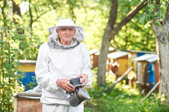 Senior beekeeper working at his apiary Royalty Free Stock Photo