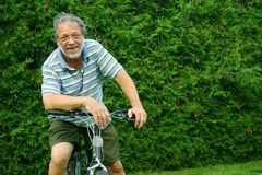 Senior and bicycle Royalty Free Stock Photography