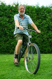 Senior and bicycle Stock Photos
