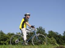 Senior on bike Stock Image