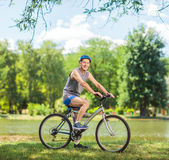 Senior biker riding a bike in park Royalty Free Stock Photography