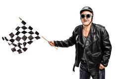 Senior biker waving a checkered race flag Stock Photography