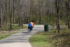 Senior Bikers on a trail in the Wolf River Greenway Royalty Free Stock Image