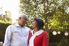 Senior black couple in their garden looking at each other Royalty Free Stock Photos