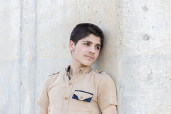 Senior boy leaning on wall Royalty Free Stock Photography