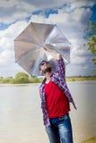 Senior boy playing with umbrella Royalty Free Stock Photography