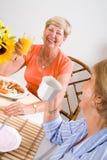 Senior breakfast. Happy senior friends having breakfast together Stock Photography