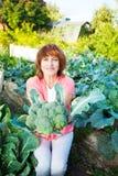 Senior with broccoli Royalty Free Stock Photo