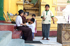 Senior Buddhist nun blessing a young boy for bett Royalty Free Stock Photography