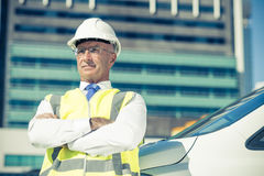 Senior builder man outdoors at construction site near his car lo Royalty Free Stock Image