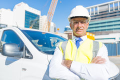 Senior builder man outdoors at construction site near his car looking in camera Royalty Free Stock Image