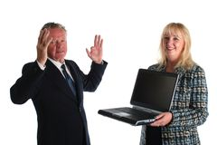 Senior businesman fed up wtih younger assistant teaching him how to use the computer Stock Photography