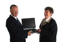 Senior businesman fed up wtih younger assistant teaching him how to use the computer Royalty Free Stock Photo