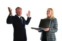 Senior businesman fed up wtih younger assistant teaching him how to use the computer Stock Image