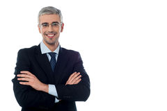 Senior business executive with arms folded Stock Images