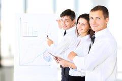 A senior business executive delivering a presentation Stock Image