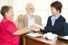 Senior Business Group Handshake Stock Photos