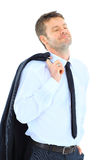 Senior business man. Portrait of a successful business executive holding his coat over shoulder on white background Stock Photo