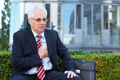 Senior business man with aching Stock Photos