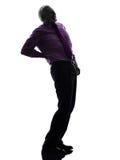 Senior business man backache pain silhouette Royalty Free Stock Photos