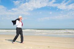 Senior business man at the beach Stock Image