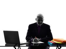 Senior business man busy working  writing silhouette Royalty Free Stock Image