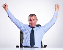 Senior business man cheers at desk Royalty Free Stock Photography