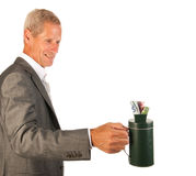 Senior business man collecting money royalty free stock images