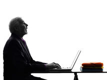 Senior business man computing looking up mouth open silhouette Stock Photos