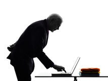 Senior business man computing typing silhouette Stock Photo
