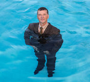 Senior business man in deep water Royalty Free Stock Photos