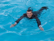 Senior business man in deep water in suit Stock Photography