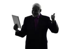 Senior business man digital tablet silhouette Royalty Free Stock Photo