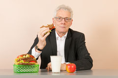Senior business man eating healthy lunch Royalty Free Stock Image